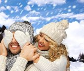 winter holidays, family, vacation and lifestyle concept - family couple in a winter clothes