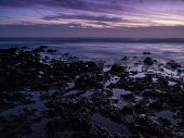 stock photo of nightfall  - nightfall at the rocky coast of Tenerife - JPG