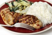 stock photo of soy sauce  - Soy sauce marinaded chicken breasts served with sauteed pak choi and Thai Jasmine rice - JPG