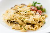 stock photo of porcini  - Pasta with porcini and chanterelle mushrooms in light cream sauce - JPG