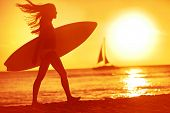 stock photo of sunny beach  - Surfing surfer woman babe beach fun at sunset - JPG