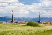 stock photo of oil drilling rig  - an oil drilling rigs in the oil fields of Wyoming - JPG