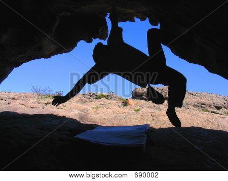 Climber In Cave