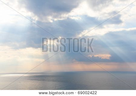 Light Rays Through The Clouds Over Sea