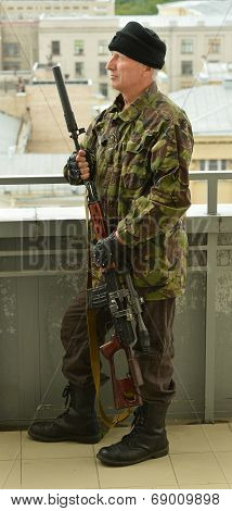 Armed senior man with weapon