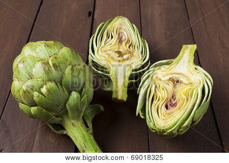 Artichoke Cut In Half On Brown Table