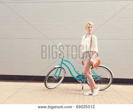 Beautiful Blonde Girl Is Standing Near The Vintage Bicycle With Brown Vintage Bag, Warm, Toned