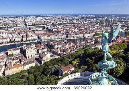 Lyon, France, viewed from the top of Notre Dame de Fourviere, with statue of St George. Mont Blanc is visible on horizon.