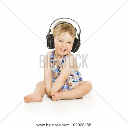 Baby In Headphones Listening To Music, Small Child Isolated Over White Background