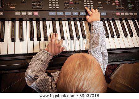 Boy Child Kid Playing On Digital Keyboard Piano Synthesizer