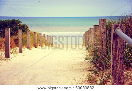 Retro Vintage Filter Sandy Path With Wooden Rails Leading Down To Beautiful Blue Ocean Beach.