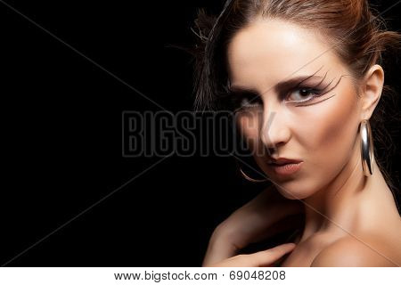 Woman With Feather And Goth Make Up