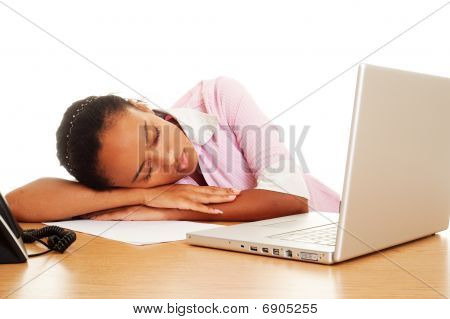 Tired Woman Sleeping At The Workplace