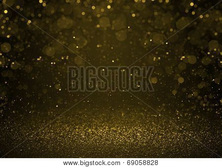 Higlighted bokeh gold sparkle glitter background. Defocused glitter stars background