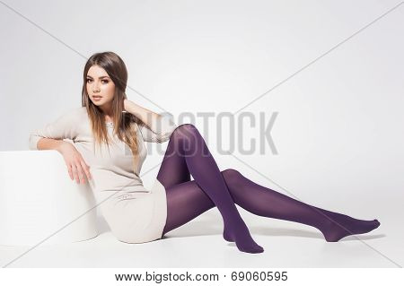 Beautiful Woman With Long Sexy Legs Wearing Stockings Posing In The Studio - Full Body
