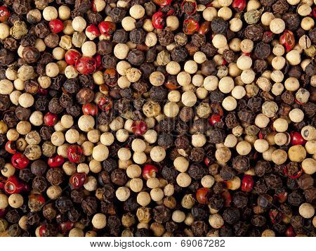 Background Image Of Mixed Red, White And Black Peppercorns