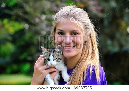 Teen girl and kitten