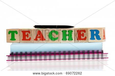 Word TEACHER composed from wood cubes and book, isolated on white background
