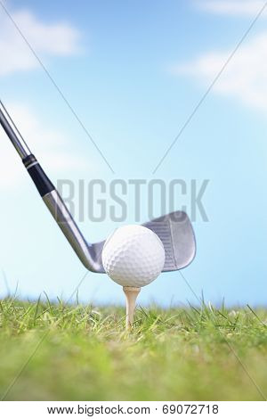 Golf Club Teeing Off Ball
