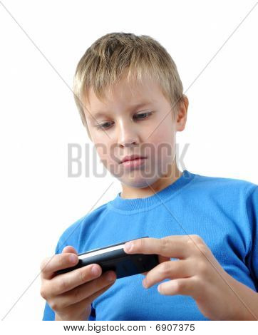 Boy Is Browsing On Mobile Phone
