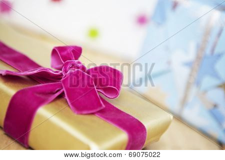 Closeup of Christmas gift wrapped with velvet bow