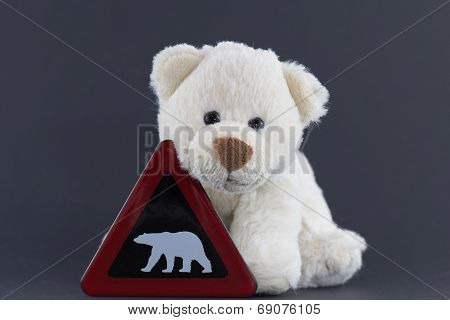 Cute Polar Bear Cub With Warning Sign
