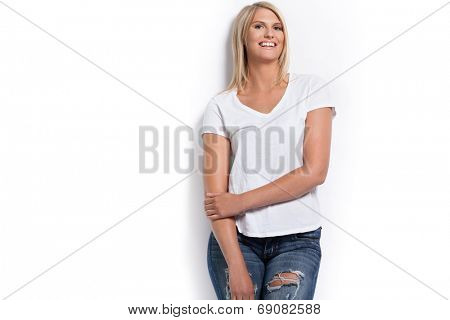 Young attractive happy girl in white shirt.