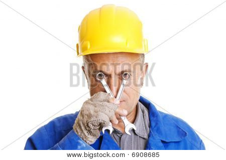 Workman Looking Through Screw Keys