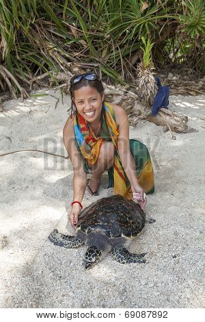 Filipino Woman And Green Sea Turtle