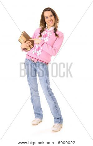 Young Student Pointing On Pile Of Books
