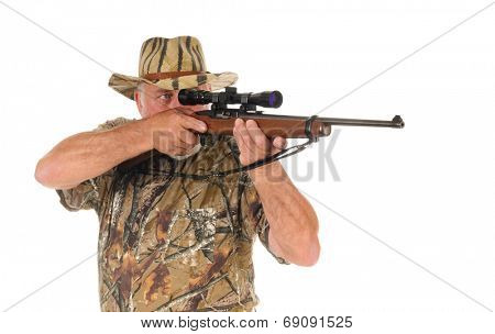 Closeup of an older hunter taking aim on his target, illustrating the correct position for trigger finger until ready to shoot