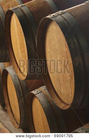 Closeup of wine casks in cellar