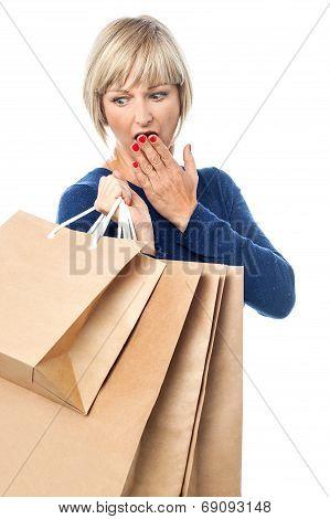 Amazed Shopping Woman Isolated On White