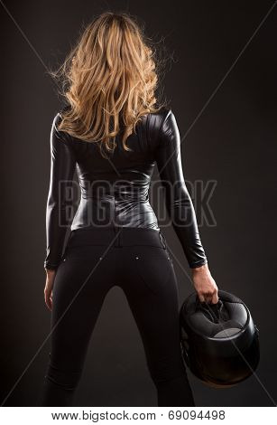 Beautiful and sexy woman back and butts in black shiny dress and helmet