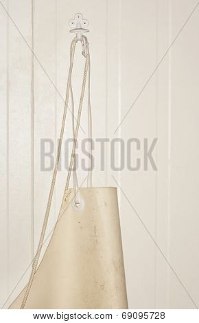 Extreme closeup of a butcher's apron hanging on wall