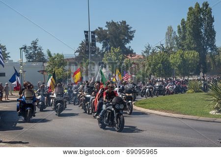 FARO - JULY 20: Motorcycle parade in the streets at the XXXIII - International Motorcycle Meeting in Faro, Portugal, July 20, 2014