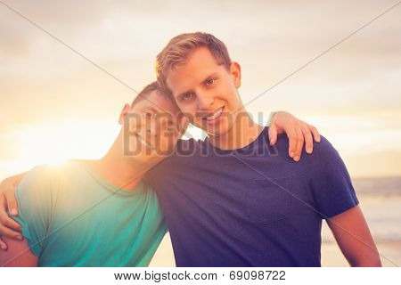 Gay couple on the beach at sunset