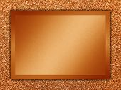 picture of bronze silver gold platinum  - Orange colored metallic plate on a orange metallic background - JPG