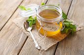 stock photo of jar jelly  - Homemade mint jelly in glass jar - JPG