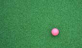 stock photo of miniature golf  - Pink golf ball used during miniature golf - JPG