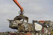 stock photo of scrap-iron  - Large blocks of low grade steel at a metal recycle scrap yard - JPG
