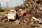 foto of junk-yard  - Large pile of old steel at a metal recycling scrap yard - JPG