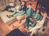 stock photo of exams  - Group of multi ethnic young students preparing for exams in home interior  - JPG