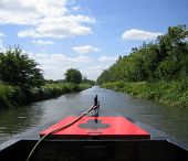 picture of chug  - Narrowboat on a river - JPG