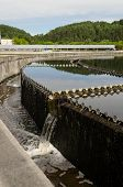 stock photo of sewage  - Reservoir of cleaned sewage water clarification step in treatment waterworks - JPG
