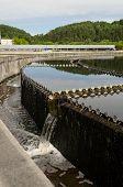 stock photo of sewage  - Reservoir of cleaned sewage water clarification step in treatment waterworks - JPG