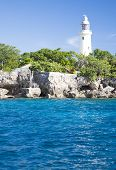 pic of jamaican  - White lighthouse on Jamaican coastline in the Caribbean - JPG