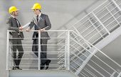 foto of stairway  - Full length of young male architect discussing on stairway - JPG