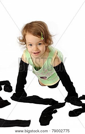 A girl tries on the clean socks of dad.