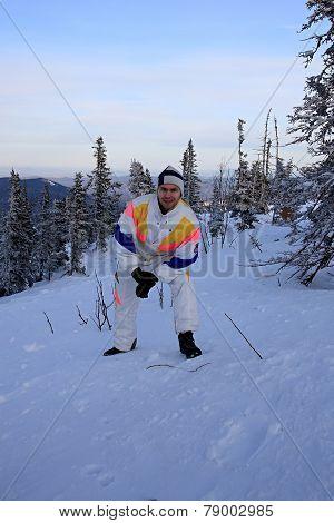 Mountain-skier on the top of mountain.